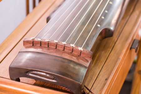 traditional chinese musical instrument name guqin or ku-ch'in zither Foto de archivo