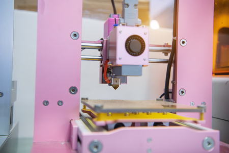 additive manufacturing: 3D printer on a pink background Stock Photo