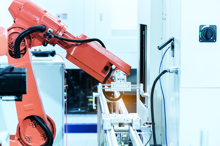 industrial industry: industrial machine and factory robot arm,Smart factory industry concept.