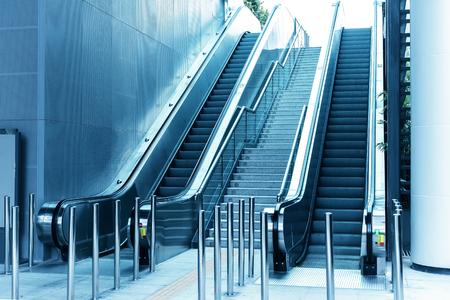 lift gate: ascending escalator in a public transport area
