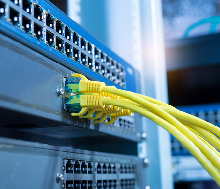 wire: ethernet cable on network switches background
