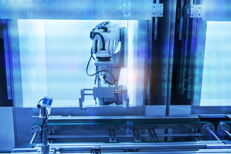 industrial industry: robotic arm machine tool at industrial manufacture plant,Smart factory industry 4.0 concept.