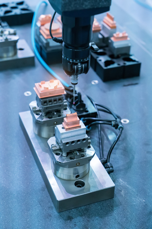 industrial machine robot in assembly line working in factory.