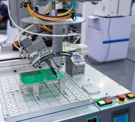 Robot Welding in assembly line working in factory. Smart factory industry 4.0 concept. Stock Photo