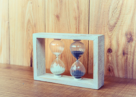 ancient pass: Hourglass on wooden background