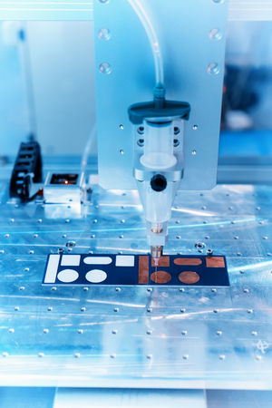 Robot holding glue syringe Injection on Circuit board