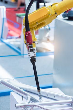 Industrial robotic arm for welding. Banco de Imagens
