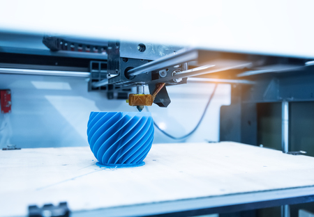 Modern 3D printer printing figure close-up macro Foto de archivo