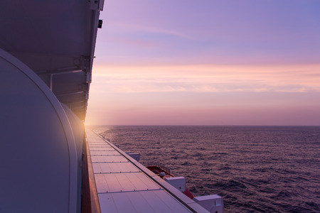 stateroom: view of luxury ocean liner deck in sunset