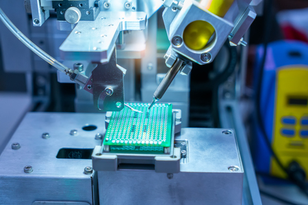 PCB Processing on CNC machine working in factory Stock Photo