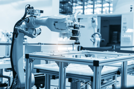 industrial machine and factory robot arm,Smart factory industry concept.