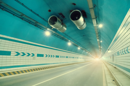 Car driving in to tunnel. Stock Photo