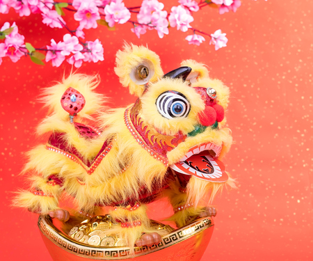 traditional chinese dancing lion with Gold ingot