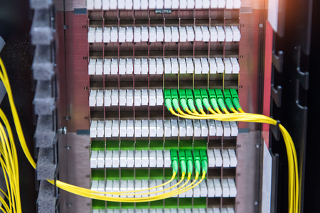 Fiber Optic cables connected to an optic ports  Stock Photo