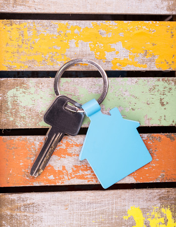 house key on wooden background Archivio Fotografico