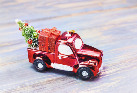 Car Christmas Ornaments.Christmas Ornaments And Car Toy With Tree Presents On Wooden