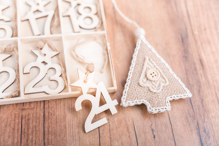24 Days till Christmas vintage style wood calendar with festive tree on wooden background,Christmas eve time concept