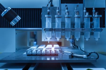 Robot holding glue syringe Injection