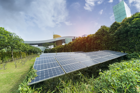 solar panel plant with urban landscape landmarks,Ecological energy renewable concept.