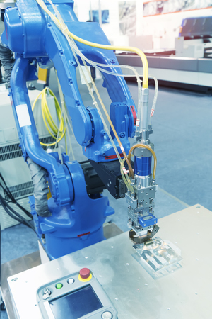 robotic hand machine tool at industrial manufacture factory.