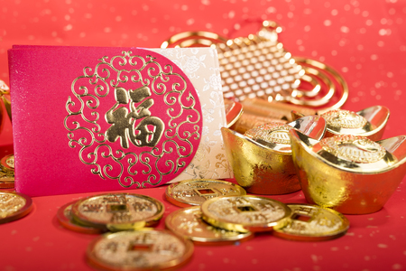 Chinese New year red envelope packet with gold ingots on red paper,Chinese Language on envelop mean Happiness and on ingot and coin mean Wealthy.