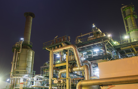 Refinery industrial plant with Industry boiler at night Imagens