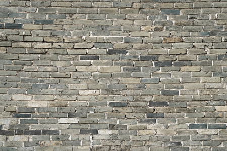 Stone wall texture background of grey brick stones. Stock Photo