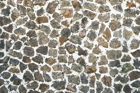 Stone wall texture background of grey brick stones. Stock Photo