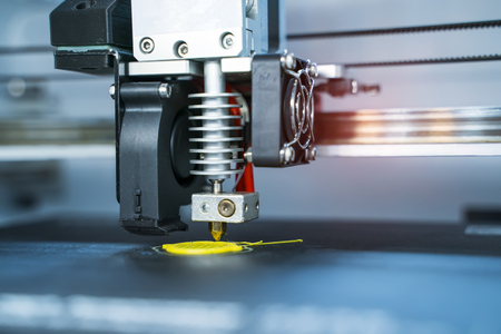 3D printer or additive manufacturing and robotic automation technology. Stock Photo