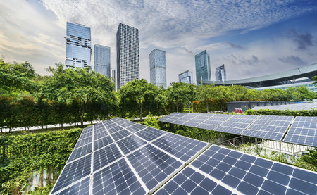 solar panels with cityscape of modern city,Ecological energy renewable concept.