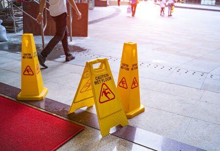 Caution wet floor sign interiors Imagens