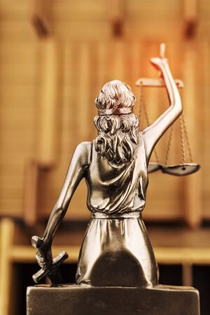 Law theme,Lady Justice Statue on wooden background,law concept Archivio Fotografico