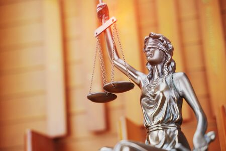 Law theme,Lady Justice Statue on wooden background