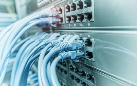 Network cable panel, switch in data center Banco de Imagens