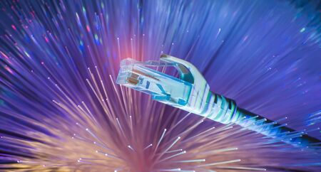 network cables with fiber optical background Stock Photo