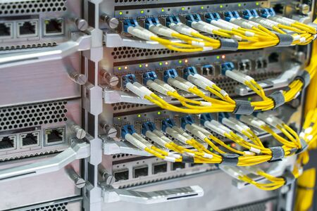 Fiber optic cable connect to communication Distribution point Stock Photo