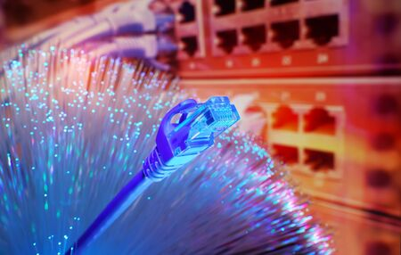 network cables with fiber optical technology background,Communication Concept