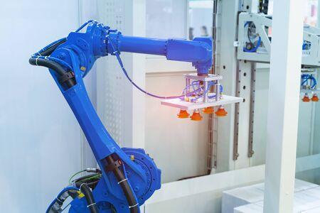 robotic pneumatic piston sucker unit on industrial machine,automation compressed air factory production Foto de archivo