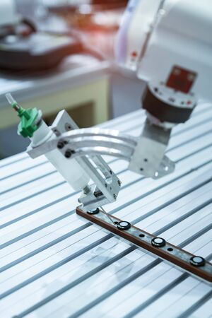 Robot holding glue syringe Injection in factory