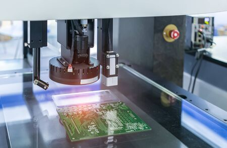 Vision measuring instrument inspecting PCB circuit board Stock Photo