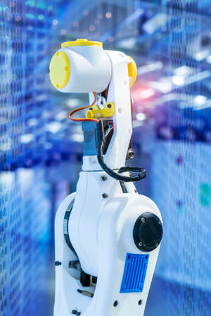 robot arm is working smartly in the production department in artificial intelligence factory Stock Photo