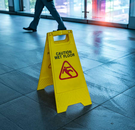 Caution wet floor sign on wet floor