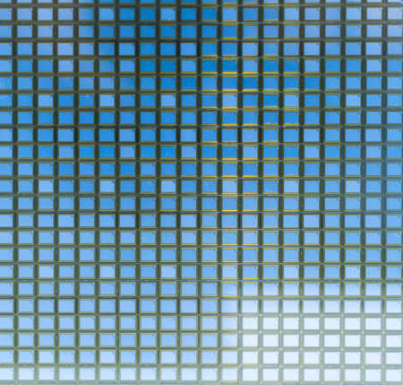 detail of a silicon wafer reflecting different colors. Reklamní fotografie
