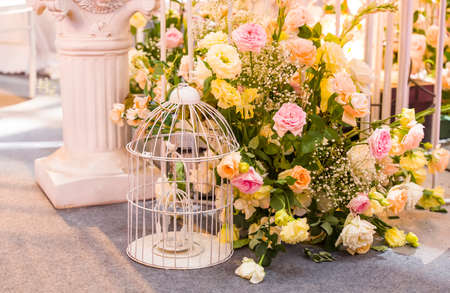 wedding decoration with beautiful vintage birdcage and flowers.