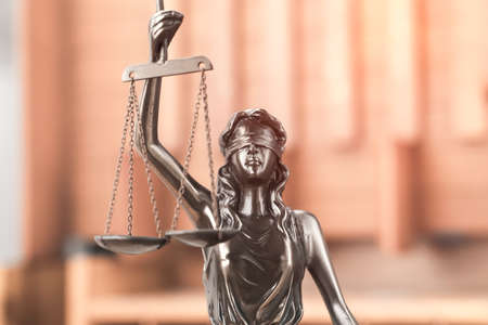 Law theme, Lady Justice Statue on wooden background