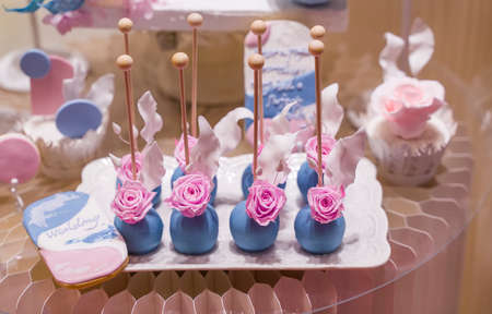 Wedding decoration with colorful cakes.