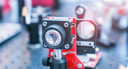 Experiment with laser device in optical laboratory