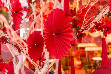 Chinese paper fans in pastel colors on wedding