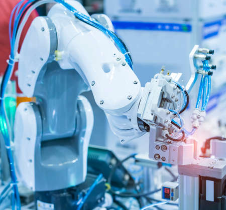 robot gripping and smart robot working on smart factory,industry 4.0 and technology. Stock Photo