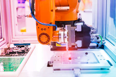 robot gripping and smart robot working on smart factory,industry 4.0 and technology. Banco de Imagens